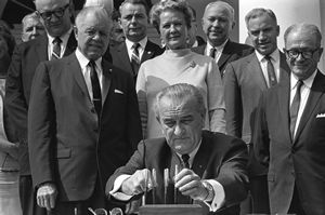 Pres. Lyndon Johnson signing food stamp act 31 August 1964